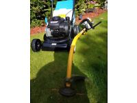 Self drive petrol lawn mower with petrol strimmer