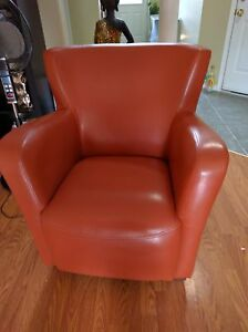 Orange copper tone leather chair