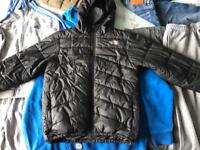 Boys clothes mixtures of jogging trousers, tracksuit, jeans, jacket and trainers.