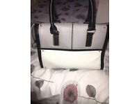 Woman's small black, grey and white bag