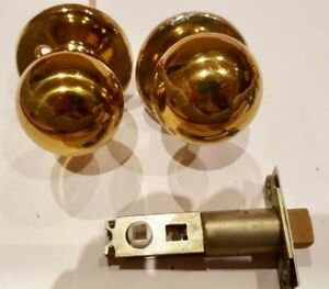 A Dozen of brass door knobs