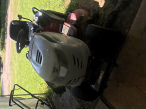 Lawnmower with snowblower attachment