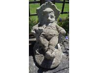 GARDEN ORNAMENT/FIGURE GNOME SLEEPING IN CHAIR, WEATHERED RECONSTITUTED CONCRETE STONE