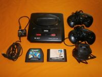 Sega Megadrive 2 with all official leads 2 official pad and 2 games