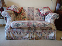 Two seater sofa, in bright floral material