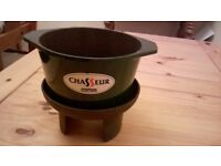 AS NEW BLACK CAST IRON CHASSEUR AND STAND.