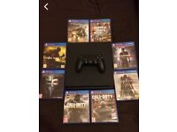 PS4 SLIM WITH 8 TOP GAMES - BARGAIN