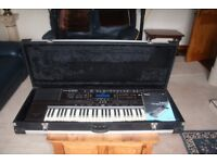 Roland E500 Keyboard complete with flight case