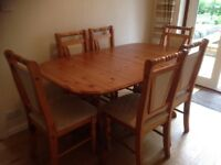 Pine extending table and chairs.