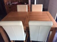 Solid oak dining table and chairs from Oak furniture land