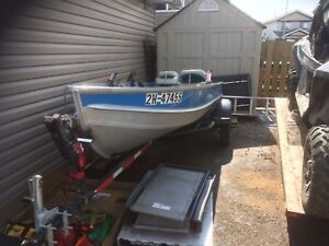 14 foot aluminum boat with 25HP and trailer