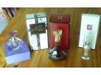 2x perfume and perfume bottle, Eyesential under eye enhancer.
