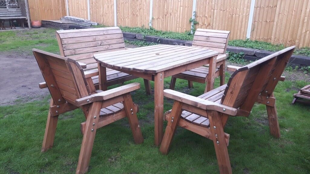 Garden table 2 chairs 2 benchessolid rustic pine3 month oldin New Haw, SurreyGumtree - A really lovely garden/patio set had very little use only 3 months old made from thick, rustic solid pine the set comprises of a table with a parasol hole in the middle 2 carver chars and 2 benches these have high supportive backs and wide...