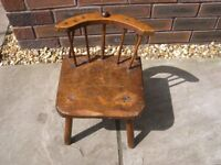 An old rustic spindle back child's chair.