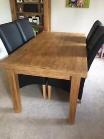 Hand made wooden table with chairs