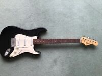 Fender stratocaster squire guitar.