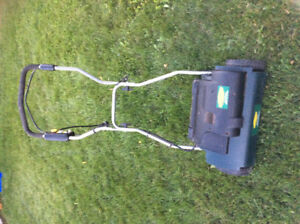 Yard works 10amp electric de thatching machine.  Excellent condi