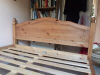 Solid pine double bed.