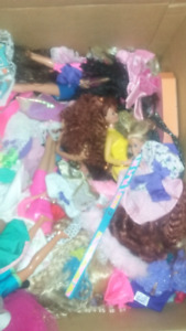 Box of barbies and barbie clothing
