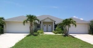 BEAUTIFUL SPACIOUS SIDE BY SIDE DUPLEX WITH DOUBLE GARAGES