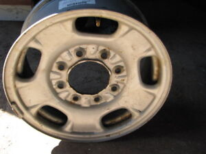 """4 nearly new 17 """" GM  8 hole rims with sensors for 3/4 ton truck"""