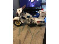 Kids ride on electric police bike