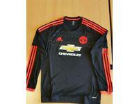Brand new Man United PLAYER ISSUE Black/Orange European 3rd kit