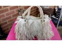 White leather fashion handbag