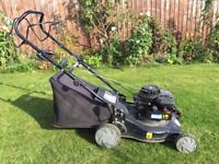 Petrol Briggs and Stratton lawn mower self propelled