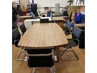 New Boardroom conference meeting table in walnut with six eames style chairs.