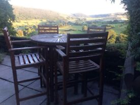 Solid wood table and 4 chairs - good condition. Quality furniture not cheap or flimsy.