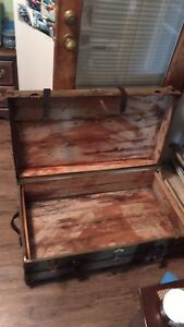 Large wooden chest with straps