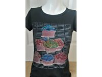 New With Tags Cute Preppy Brand Diamante CUP CAKE MOTIF Black Tee Shirt (approx size 10)