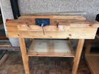 Sturdy wood working bench with removable vice.