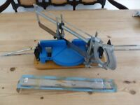 Mitre-cutting saw and spare blade.