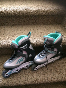 2 pairs of new roller blades