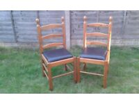 DINING CHAIRS - x2 - SOLID WOOD - FAUX LEATHER SEAT PADS