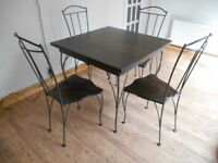 Solid wood dining room table and four chairs