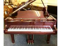 Baby grand piano by Hohner