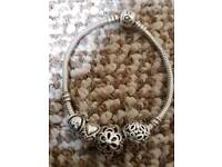 Pandora bracelet with 4 silver charms