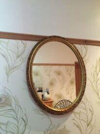 Dark gold oval mirror