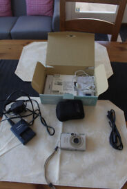 Canon Digital IXUS 950IS camera with spare battery and SD card
