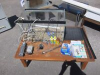 Fish tank, pumps, filter, bed, heater, pebbles and accessories