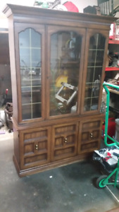 China Cabinet with glass shelves and interior light.