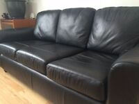 Leather look three seater sofa and two matching armchairs