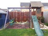 Playhouse with swings and slide