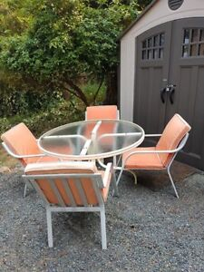 """48"""" Glass table, 4 chairs with cushions"""