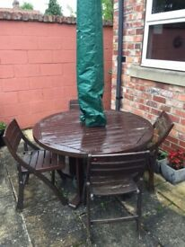 Garden Table and 4 chairs plus umbrella