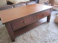 Dark wood, very good quality coffee table