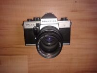 Praktica MTL 5 B film camera complete with lens, spacers and flash. Can sell lens separately.